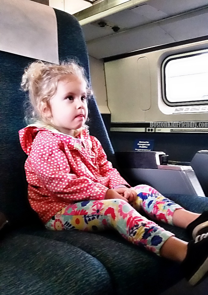 Toddler riding the Train to Maine